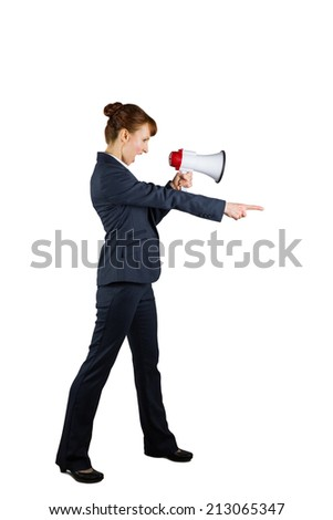 Angry businesswoman shouting through megaphone and pointing on white background