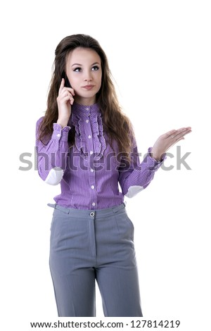 Angry businesswoman talking on the cellphone isolated on white studio shot