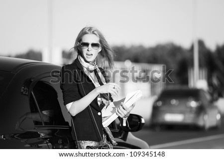 Angry businesswoman with a business papers - stock photo