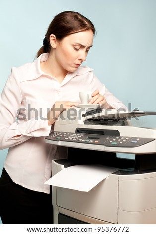 Angry businesswoman with copier thinking on the  background - stock photo
