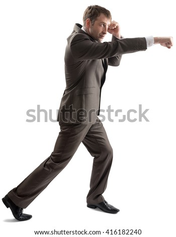 Angry caucasian business man in business formal outfit hitting isolated on white background - stock photo