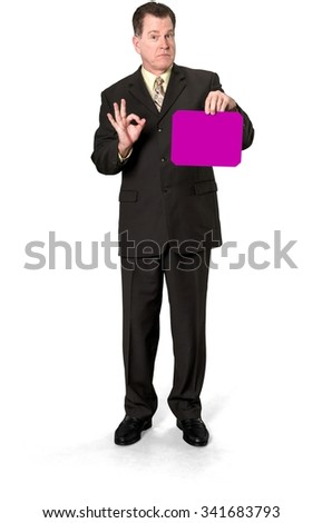 Angry Caucasian elderly man with short medium brown hair in business formal outfit holding medium sign - Isolated