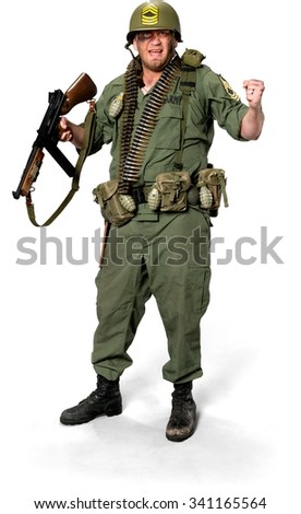 Angry Caucasian man in uniform holding machine gun - Isolated