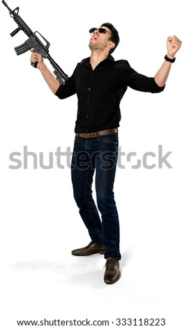 Angry Caucasian man with short black hair in casual outfit holding rifle - Isolated