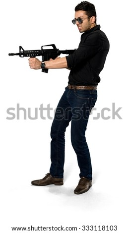 Angry Caucasian man with short black hair in casual outfit using rifle - Isolated