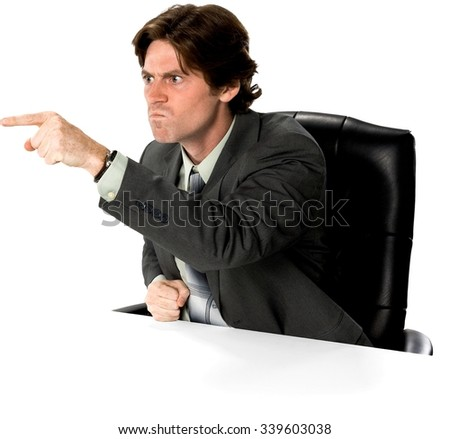 Angry Caucasian man with short dark brown hair in business formal outfit pointing using finger - Isolated