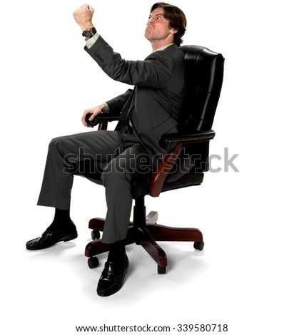 Angry Caucasian man with short dark brown hair in business formal outfit shaking fist - Isolated