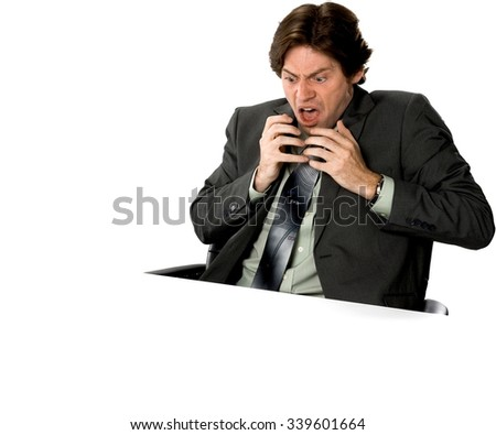 Angry Caucasian man with short dark brown hair in business formal outfit shrugs - Isolated