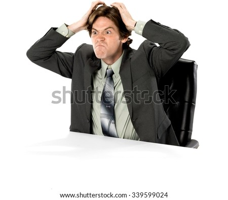 Angry Caucasian man with short dark brown hair in business formal outfit with hands on head - Isolated