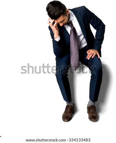 Angry Caucasian man with short dark brown hair in business formal outfit with hands on thighs - Isolated