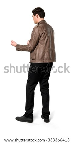 Angry Caucasian man with short dark brown hair in casual outfit shaking fist - Isolated