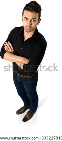 Angry Caucasian man with short dark brown hair in casual outfit with arms folded - Isolated