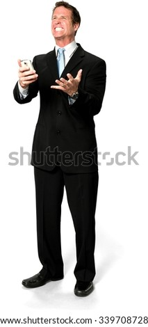 Angry Caucasian man with short medium blond hair in business formal outfit holding mobile phone - Isolated - stock photo