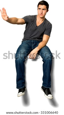 Angry Caucasian young man with short black hair in casual outfit showing stop hand - Isolated - stock photo