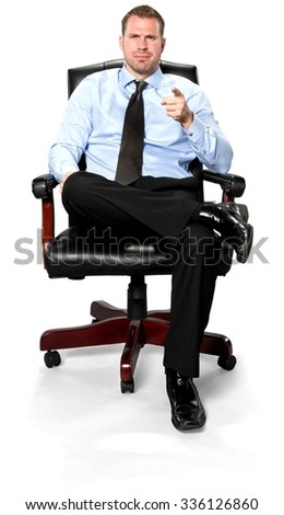 Angry Caucasian young man with short medium brown hair in business formal outfit pointing using finger - Isolated