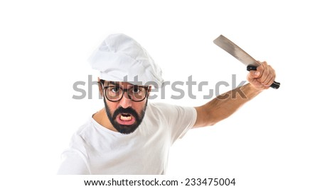 angry chef attacking with knife - stock photo