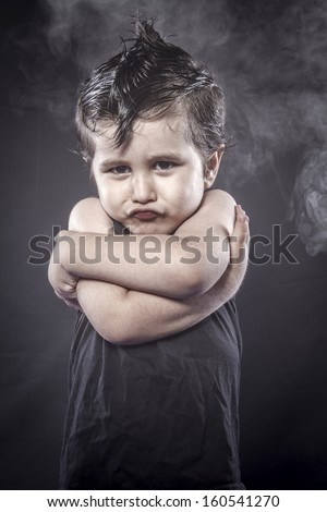 Angry, child rocker dress and funny expressions crested - stock photo