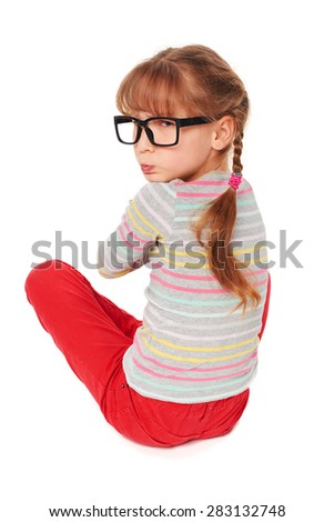 Angry child sitting on floor, isolated on white background - stock photo