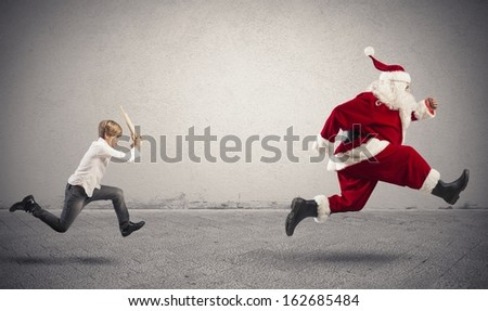 Angry child with Santa Claus for a gift wrong - stock photo