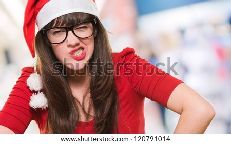 angry christmas woman wearing glasses, indoor