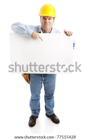 Angry construction worker holding a blank white sign.  Full body, isolated on white. - stock photo
