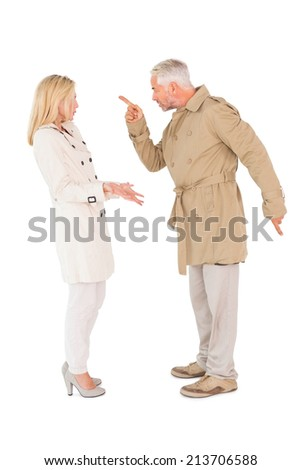 Angry couple fighting in trench coats on white background - stock photo