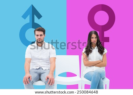 Angry couple not talking after argument against pink and blue - stock photo