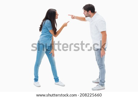 Angry couple shouting at each other on white background - stock photo