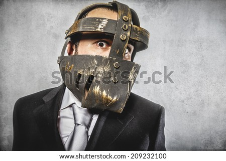 angry, dangerous business man with iron mask and expressions