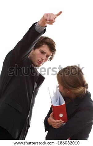 Angry employer firing his employee, holding folders. - stock photo