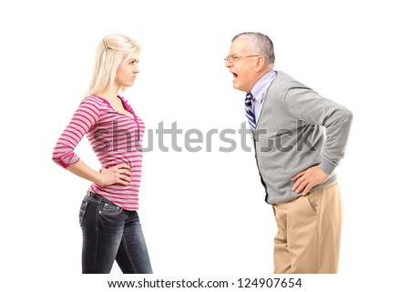 Angry father shouting at his daughter isolated on white background - stock photo