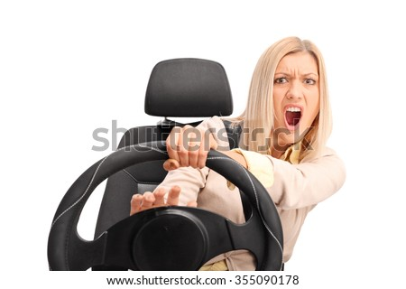 Angry female driver yelling and honking on the horn isolated on white background - stock photo