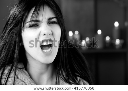 Angry female vampire looking camera