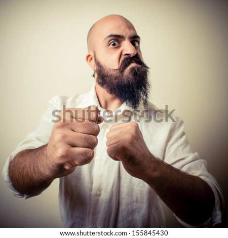 angry fighter long beard and mustache man  on gray background - stock photo