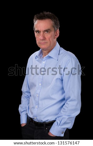 Angry Frowning Middle Age Business Man in Blue Shirt Black Background