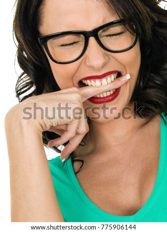 Angry Frustrated Young Woman Biting Her Finger in Frustration Wearing Glasses