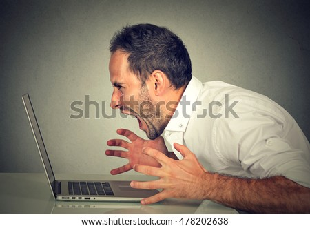 Angry furious business man screaming at computer. Negative human emotions, facial expressions, feelings, aggression, anger management issues concept