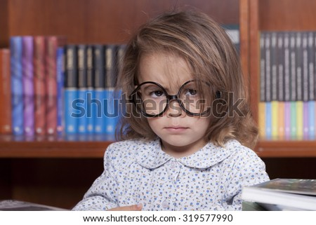 angry girl in the library - stock photo
