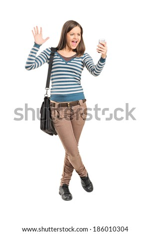 Angry girl looking at a cell phone isolated on white background - stock photo