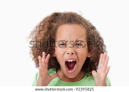 Angry girl screaming against a white background - stock photo