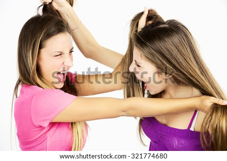 Angry girls fighting holding hair - stock photo