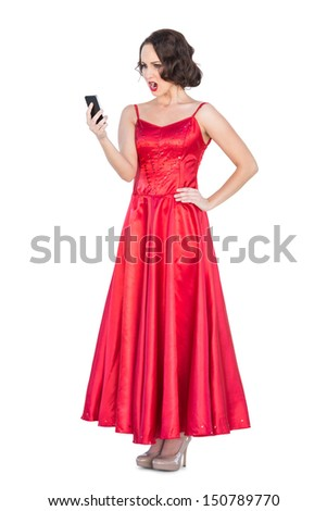 Angry gorgeous young model on the phone on white background  - stock photo