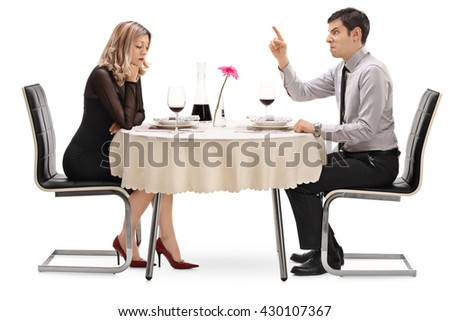 Angry guy yelling at his girlfriend and threatening with his finger isolated on white background