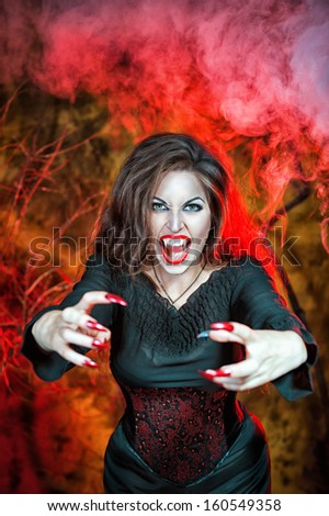 Angry halloween beautiful vampire  - stock photo