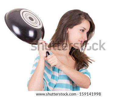 Angry hispanic woman with rage in face and saucepan in one hand - stock photo