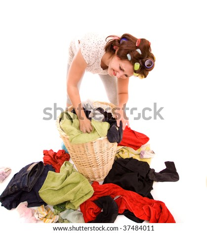 Angry housewife with a lot of washing - stock photo
