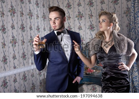 Angry husband and his wife having argue in posh, luxury apartment - stock photo