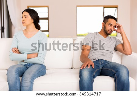 angry indian couple having conflict at home