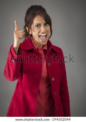 Angry Indian young woman scolding somebody - stock photo