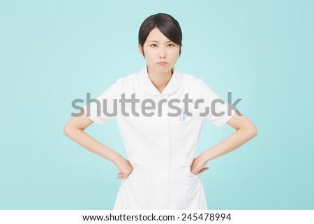 angry Japanese nurse - stock photo